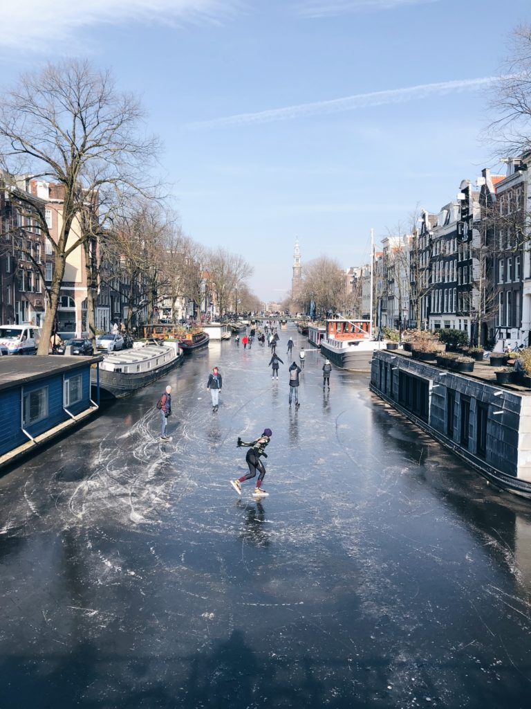 People iceskating on the canals of Amsterdam
