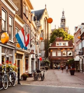 Typical street in Holland with Dutch flags